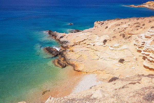 rocks beach blue water koufonisia koufonissia greece