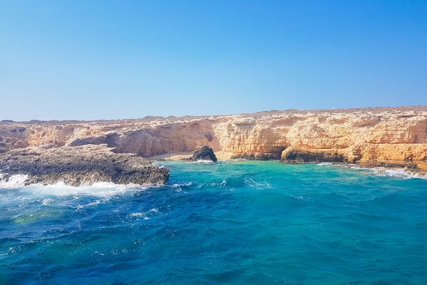 rocks beach blue water glaros island koufonisia koufonissia greece