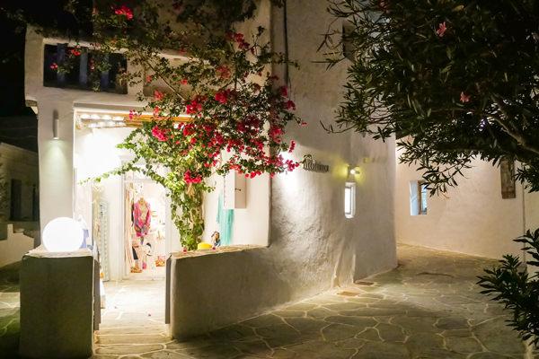 night photo of cute clothes shop folegandros greece