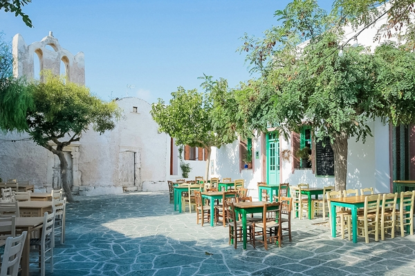 church and square with tables folegandros greece